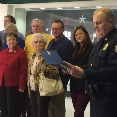 "In this file photo, Gallatin Police Chief Don Bandy, right, reads a certificate honoring Dr. Jerry McMillan (back row, center right) and his actions to save James ""Hack"" Gillum (back row, center left) during a Nov. 24 Lions Club meeting."