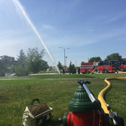 Tosa Fire Department blasts water into the air to test out new fire truck