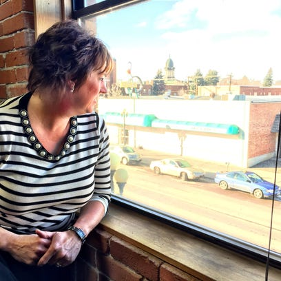 Trina Knoche surveys downtown Great Falls from her second-floor Farmer's Insurance office. Knoche is February's Hometown Hero, nominated by her fellow Downtown Chick Michelle Chenoweth.