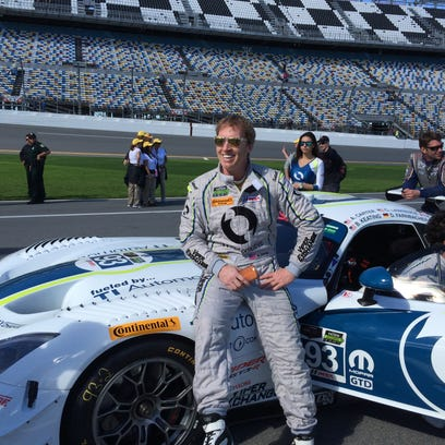 """Al """"Scott"""" Carter, a Claymont native, poses with the GT Division-winning car in Sunday's 2015 Rolex 24 at Daytona."""
