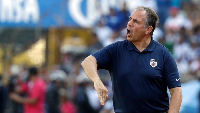 United States coach Bruce Arena gives instructions to his players during the match.