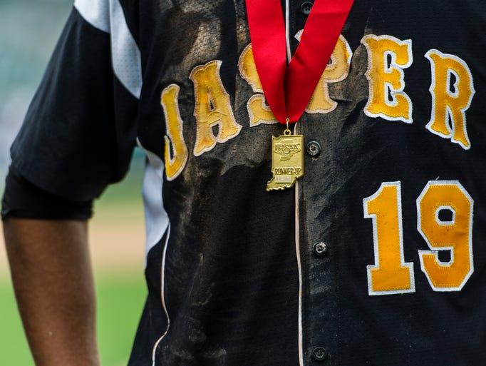 Jasper's Evan Aders (19) wears a runner-up medal after