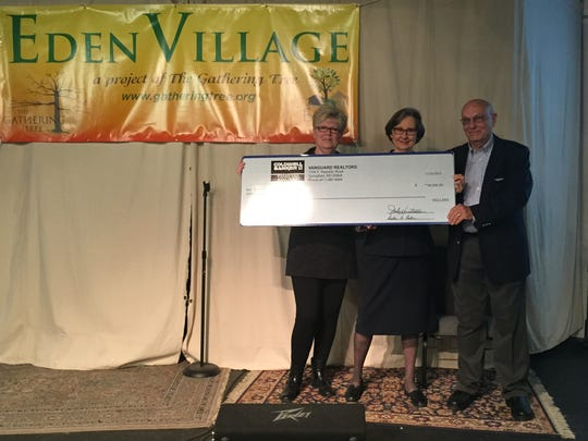 Judy Huntsman, broker and owner of Coldwell Banker Vanguard Realtors, presented a check for $30,000 on Monday to Gathering Tree founders Linda and David Brown. Gathering Tree plans to use the money to purchase the first tiny home for Eden Village, a planned-community of tiny homes for disabled, chronically homeless people.