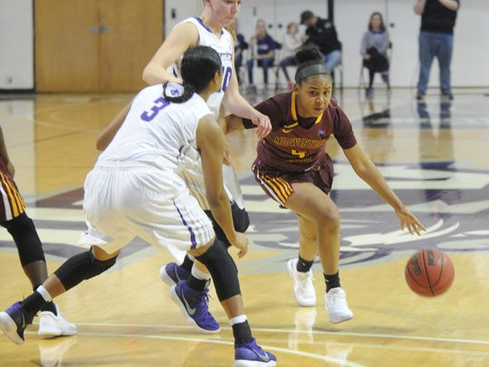 Midwestern State's Chelcie Kizart, right, tries to drive past Abilene Christian's Breanna Wright and Dominique Golightly (3). ACU won the nonconference game 88-67 Saturday, Dec. 16, 2017 at Moody Coliseum.