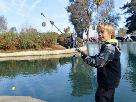 Fenix Toley, 6, casts out his line after catching his
