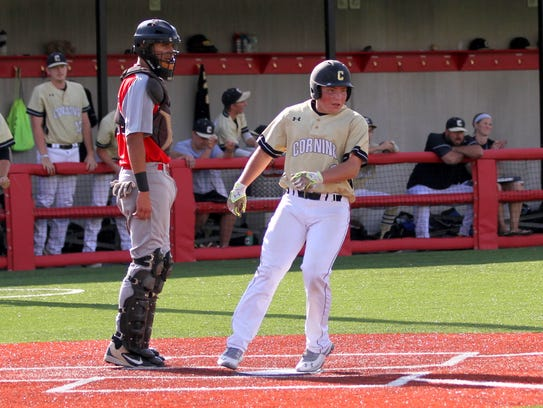 Corning's Zach Turner scores on a ground out and watches