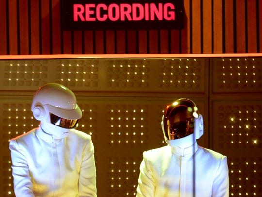 Daft Punk perform on stage for the 56th Grammy Awards at the Staples Center in Los Angeles, California, January 26, 2014.