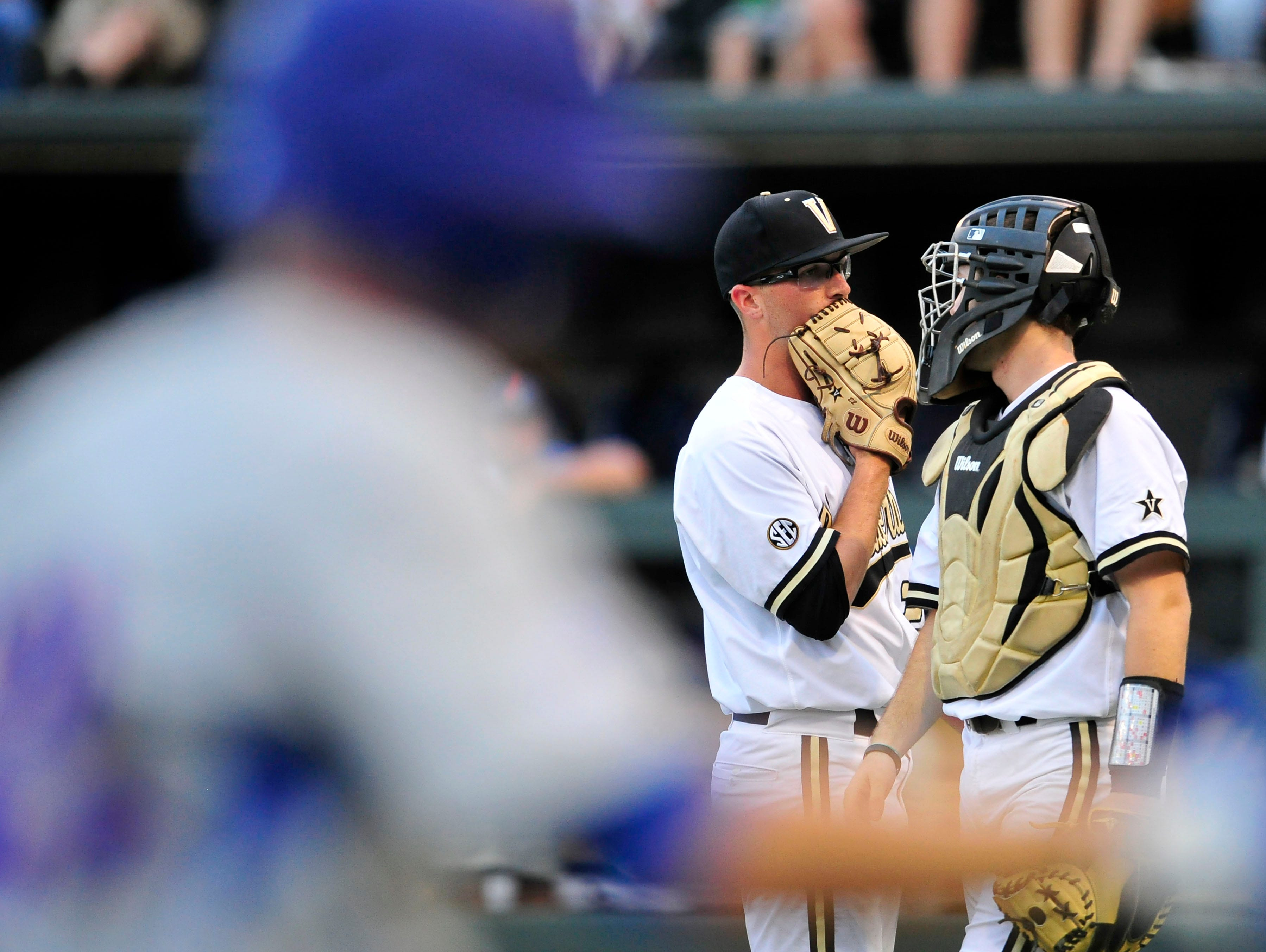 Vanderbilt starter Philip Pfeifer, center, talks with catcher Jason Delay as Florida's Richie Martin circles the bases after his two-run home run in the second inning Friday.