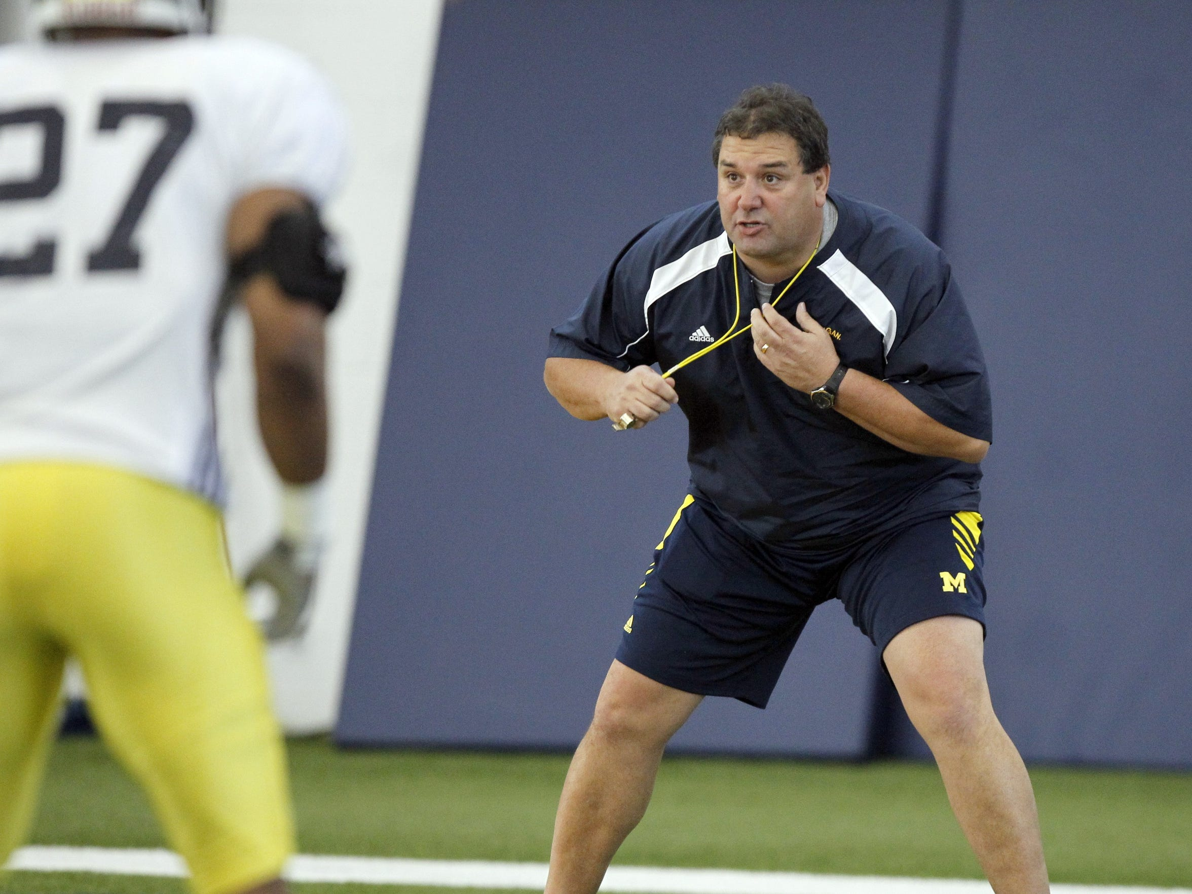 Michigan head coach Brady Hoke was all over the field as he ran his first season of Michigan spring football practice on March 29,  2011.