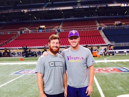 Jake McQuaide (left) and Kyle Rudolph took time to reunite in St. Louis on Sunday as the Rams played the Vikings