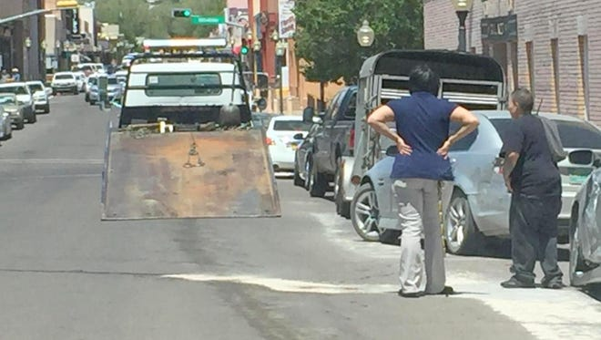 People are left wondering what happened after a truck collided with four parked cars during an accident in downtown Silver City.