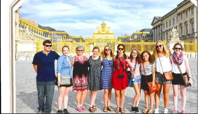 Newly retired French teacher Rebecca Zelent, third from left, and her students from Wausau East High School pose in front of Versailles days before the attack in Nice, France.