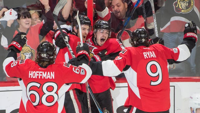 Ottawa Senators players celebrate their double-overtime win over the New York Rangers.
