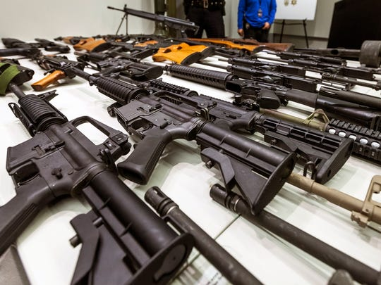 A variety of military-style semi-automatic rifles obtained