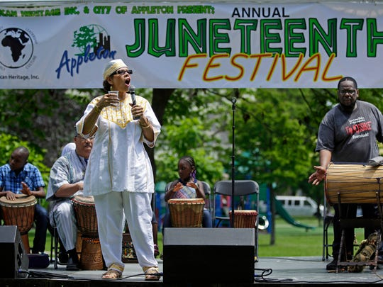 D. Kucha Brownlee of the storytelling duo Kucha and Baba Tony opens the Juneteenth Celebration with a libation ceremony that remembers and gives thanks to ancestors. The festival took place at City Park Sunday, June 19, 2016 in Appleton, Wisconsin. Ron Page/USA TODAY NETWORK-Wisconsin