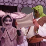 Walter Alexander (Shrek) and Ryan Smith (the donkey) run through a scene during rehearsal Monday.
