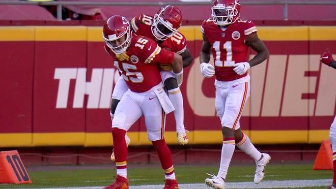 Kansas City Chiefs quarterback Patrick Mahomes (15) gives wide receiver Tyreek Hill (10) a ride on his back to the bench as wide receiver Demarcus Robinson (11) looks on following Hill's touchdown catch in the second half Sunday against the New York Jets in Kansas City, Mo.