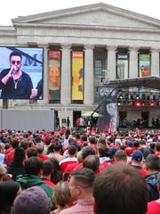 Hockey fans watch a concert by Sting and Shaggy outside