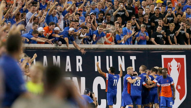 FC Cincinnati celebrates an opening goal by midfielder Corben Bone (19) in the first half of the Lamar Hunt U.S. Open Cup Semifinal match between FC Cincinnati and the New York Red Bulls at Nippert Stadium in Cincinnati on Tuesday, Aug. 15, 2017. The Red Bulls came from a 2-0 deficit to win 3-2 in overtime.