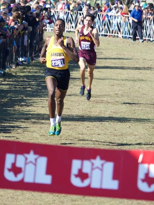 Tuloso-Midway's Ace Castillo follows Amarillo High's Butare Rugenerwa to the finish line during Saturday's UIL Class 5A State Cross Country championships in Round Rock. Castillo finished second.