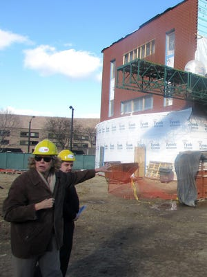 Corning Community College President Katherine Douglas describes the progress of the new health education center on Denison Parkway in Corning during a media tour Thursday.