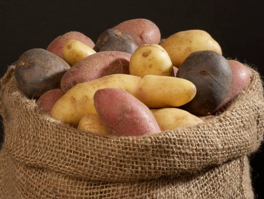 Close-up of raw potatoes in a sack