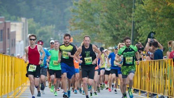Jay Curwen, center, at the start of the Asheville Running