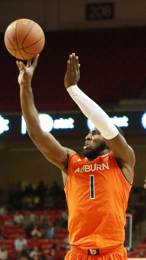 Auburn Tigers guard KT Harrell (1) shoots over Texas Tech Red Raiders guard Devaugntah Williams (0) in the second half at United Supermarkets Arena. Texas Tech defeated Auburn 46-44