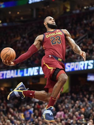 Cleveland Cavaliers forward LeBron James (23) goes for a slam dunk during the first half against the Brooklyn Nets at Quicken Loans Arena.
