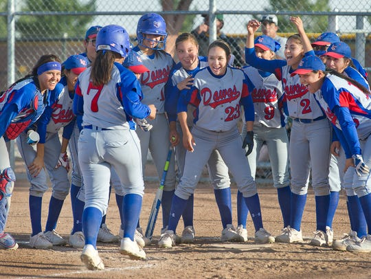 Maria Hernandez, #23, and the entire Las Cruces High