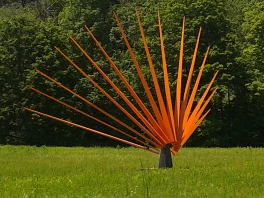 """This sculpture, called """"Setting Sun"""" by artist Tom"""