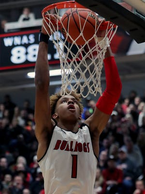 New Albany's Romeo Langford dunks the ball against Bedford North Lawrence.