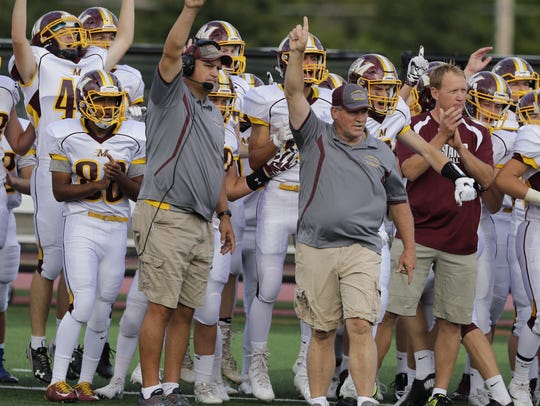 Menomonie coach Joe LaBuda reacts to a touchdown early