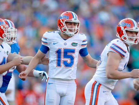FILE - In this April 8, 2016, file photo, Florida kicker Eddy Pineiro (15) celebrates after making a field goal during a spring football game in Gainesville, Fla. No. 25 Florida went from having one of the worst place-kicking situations in the country to maybe one of the best. Pineiro could be the team's most significant newcomer when it opens the season Saturday. (Matt Stamey/The Gainesville Sun via AP, File)