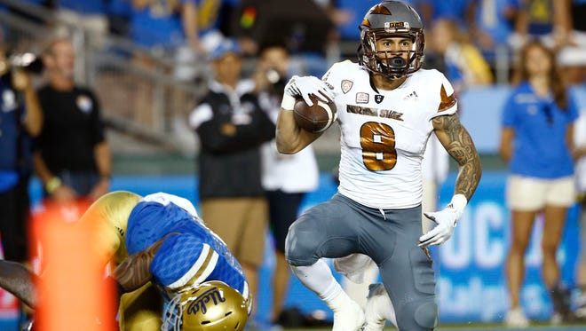 ASU's D.J. Foster scores a touchdown against UCLA in the second half on Oct. 3, 2015, at the Rose Bowl in Pasadena, Calif.