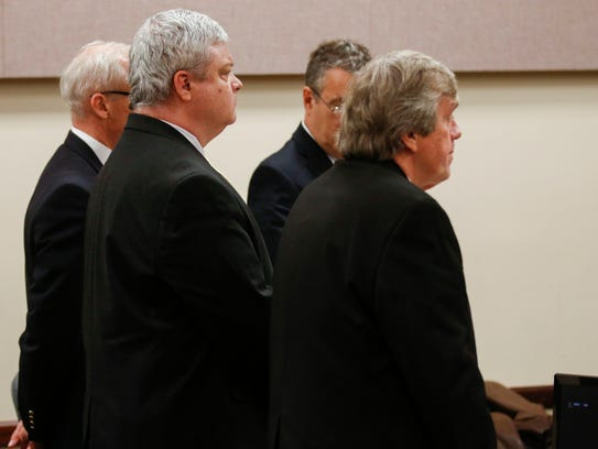 Craig Wood stands with his lawyers as he is found guilty