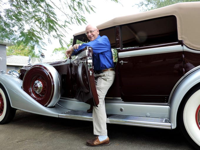 Ed Miller's maroon and silver 1933 Packard is one of