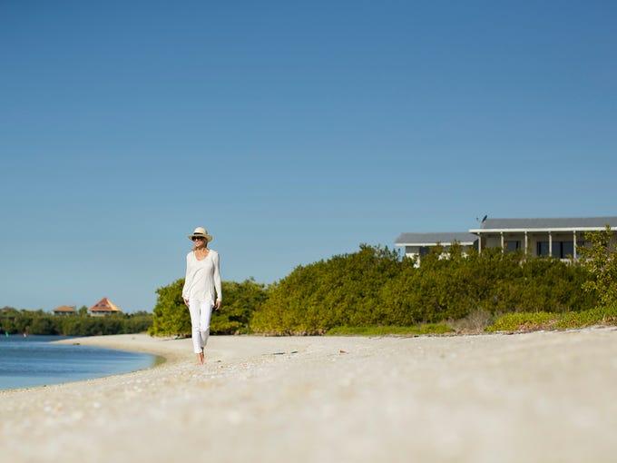 White sandy beaches skirt the buttonwood and sea grape