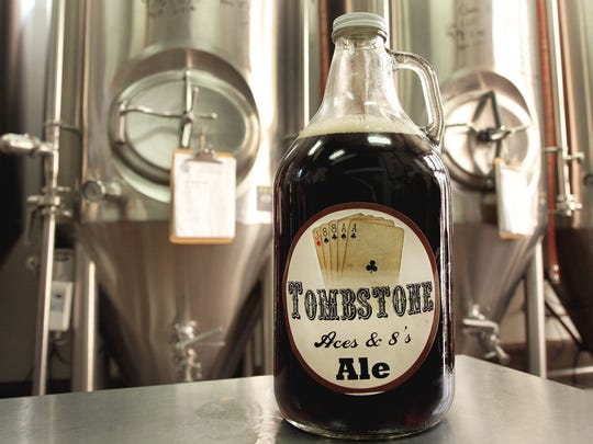 A growler of Tombstone Aces & 8's Ale sits inside Old