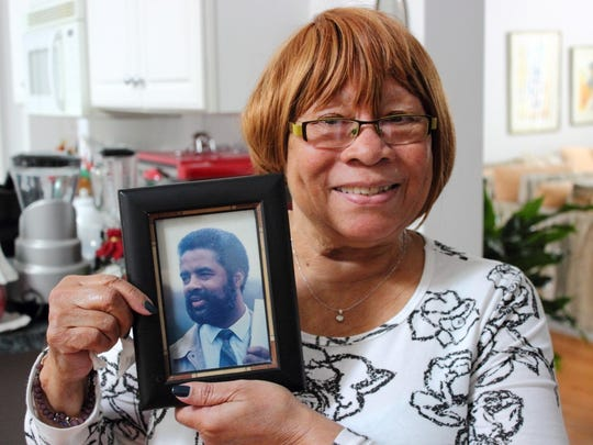 Jessie Brown holds a photo of her late husband Donald. She credits Delaware Hospice with helping both of them as Donald struggled with stage four lung cancer.