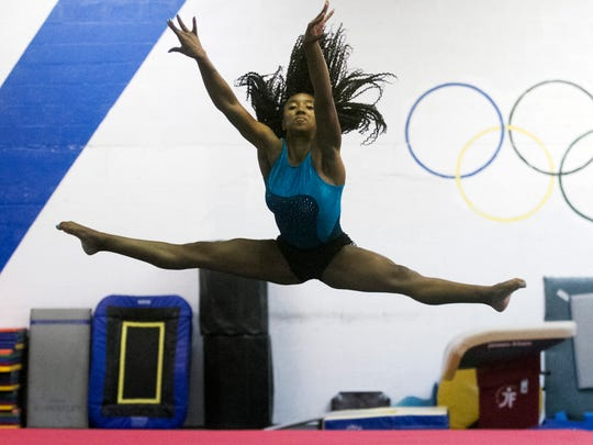 Aspen Tucker of Coast Elite Gymnastics said she felt at home when she met her new teammates at Missouri.