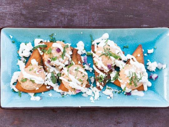 The Srir-achos at Salut Kitchen Bar pairs pita chips