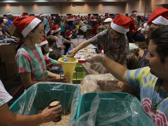 Thousands of volunteers filled Harborside Event Center on Thursday to pack more than 607,000 meals for Harry Chapin Food Bank during the Holidays Without Hunger event through Meals of Hope.