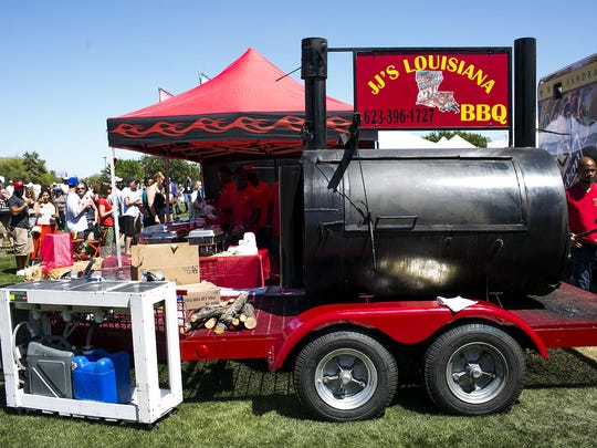 Brisket and smoked pork is brought out of the oven at JJ's Louisiana BBQ at the Great Southwest Cajun Fest, April 18, 2015, in Phoenix.