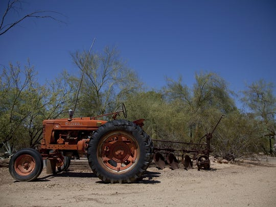 A tractor is shown in the driveway at Cattle Track