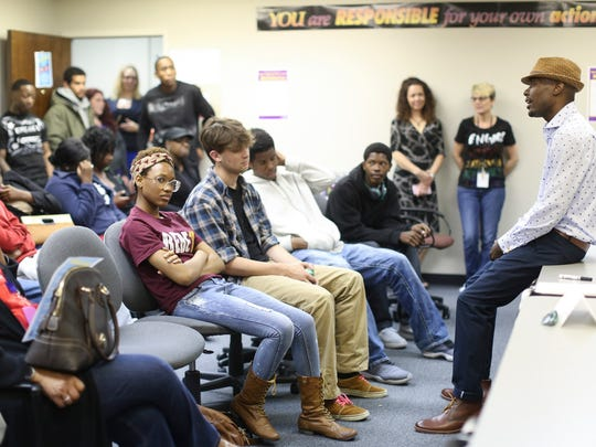Guest speaker Aubrey Williams, right, discusses his path from being shot in Louisville's west end to having sights on graduate degrees during a job fair at the Kentucky Youth Career Center in downtown Louisville.