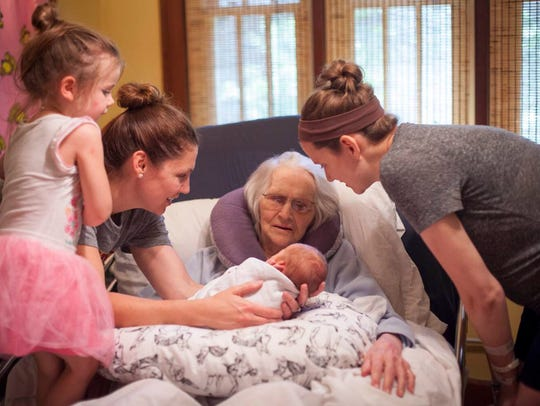 Betty Kline meets her 3-day-old 10th great-grandchild,