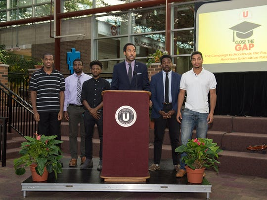 David Johns, Executive Director, White House Initiative on Education Excellence for African Americans, addresses the attendees and is surrounded by Union students who have directly benefitted from the Close the Gap Campaign.