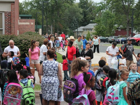 Students and families coming to school.