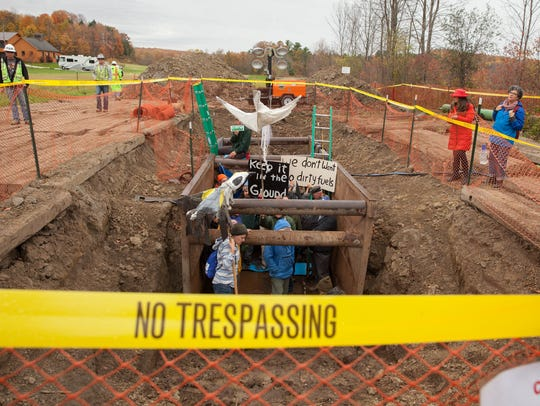 Gas pipeline protesters in Hinesburg, Thursday, climb